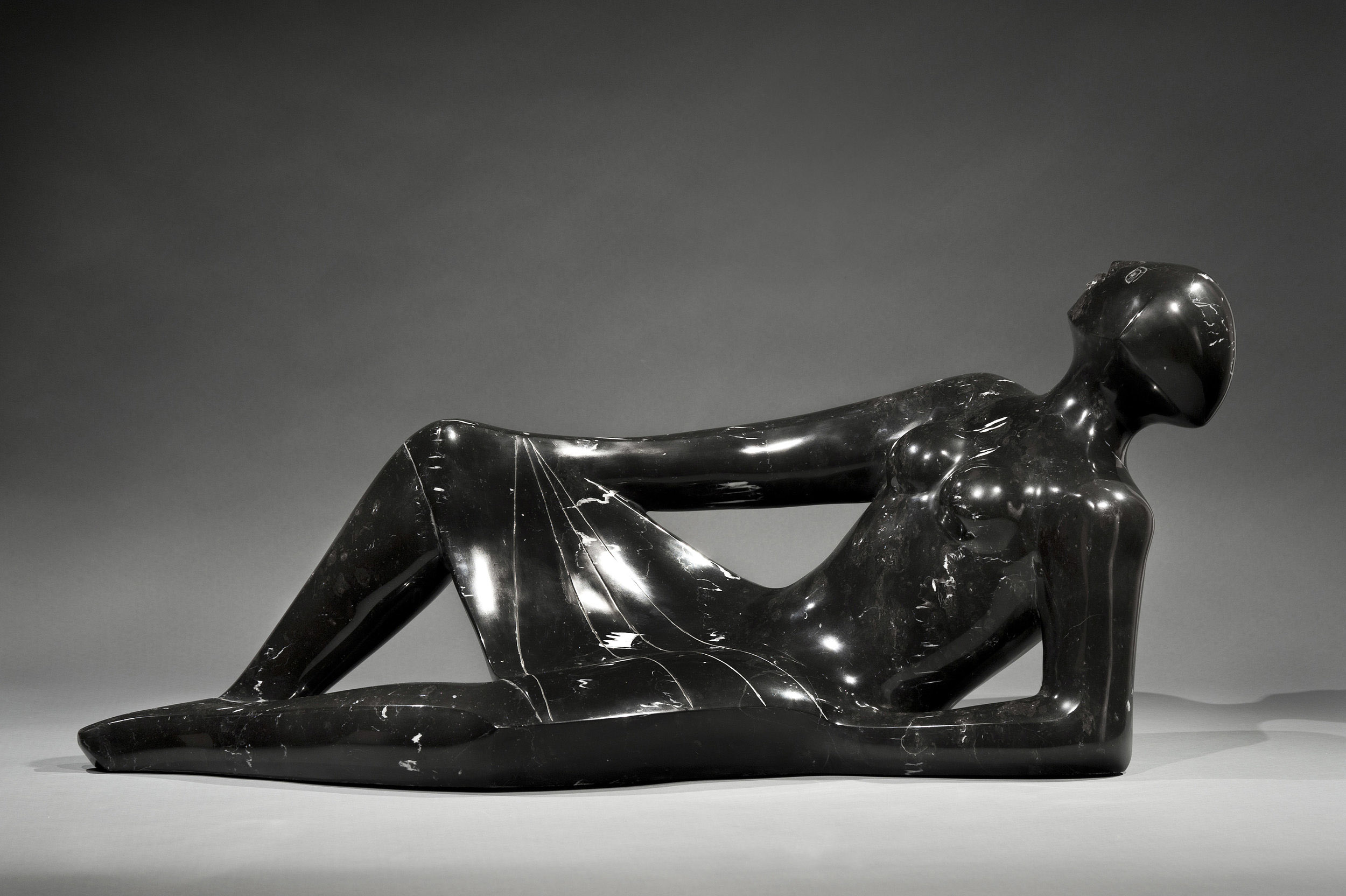 SOLD  Star Gazer, 1997  , black marble statue, 14 1/2 x 32 x 11 inches