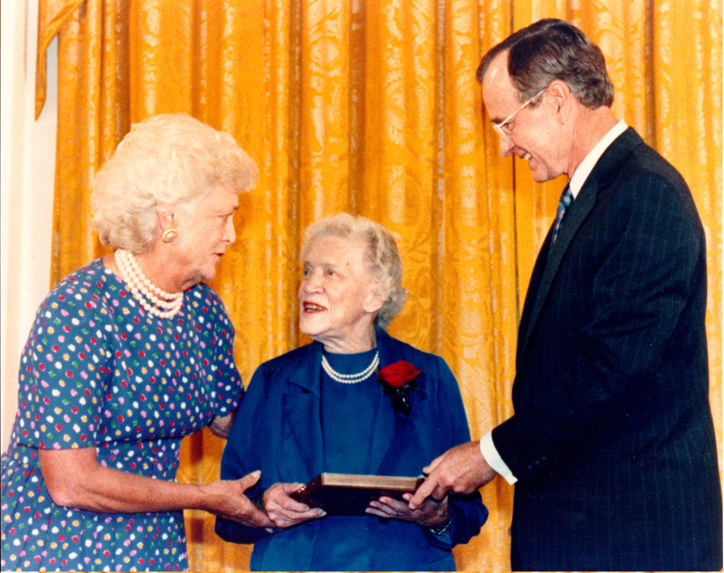 1989: Accepts the Presidential Medal of Freedom from President George H. W. Bush at a White House ceremony.