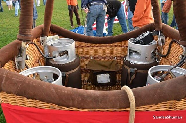 "Frequently Asked Question #11  WHAT KIND OF FUEL IS USED?  Propane is used and is kept in pressurized tanks on the floor of the basket. The balloon carries 30 to 40 gallons of liquid propane. It is carried under pressure and passes to the burners through flexible hoses. When the valves are opened, the propane atomizes and is ignited by a pilot light in the burners. The flame may shoot out as much as 10 or 20 feet, making a loud ""whoosh""."