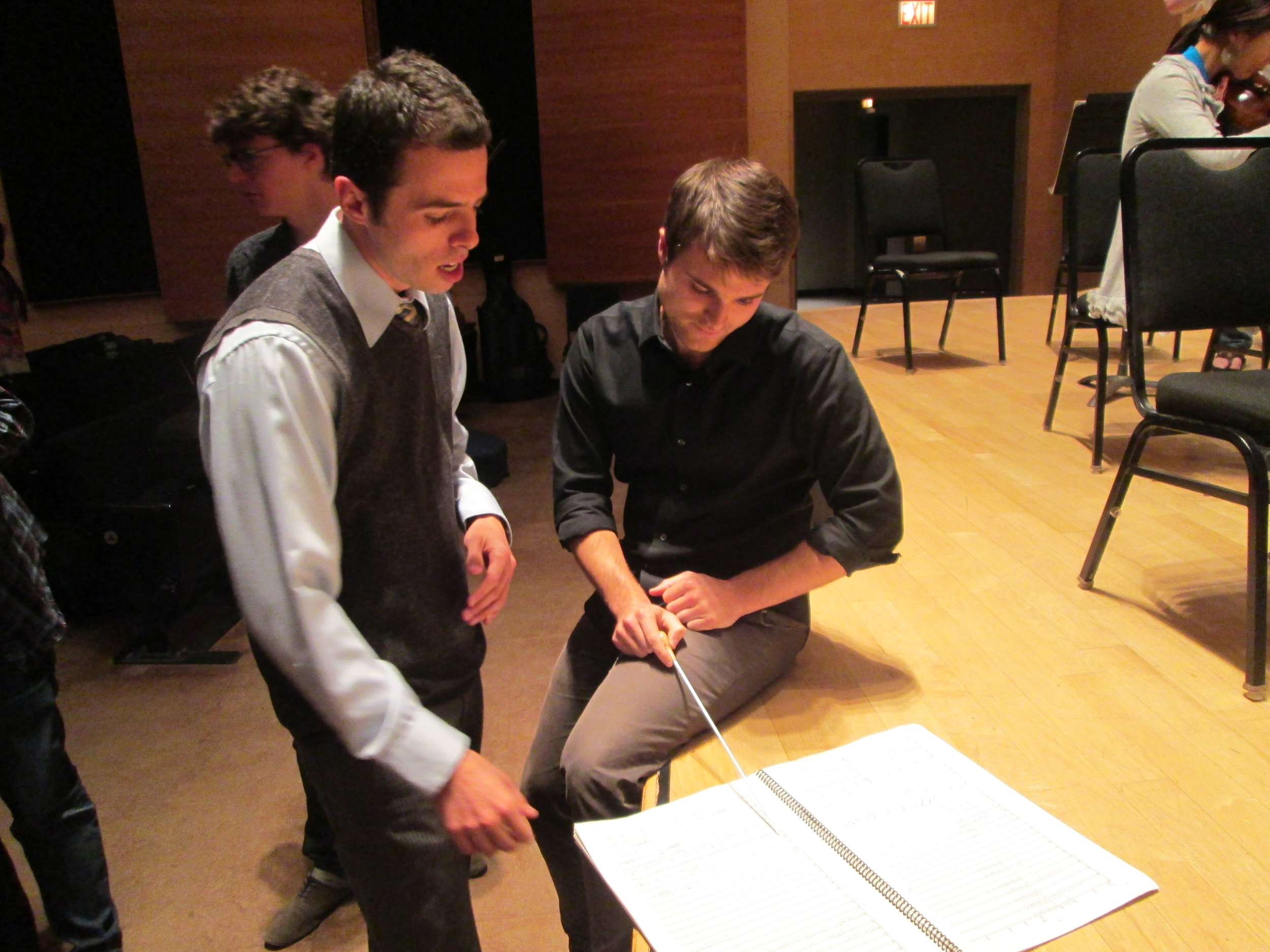 Daniel and conductor Stephen Mulligan discuss passages from  Chasm  in Harris Hall.