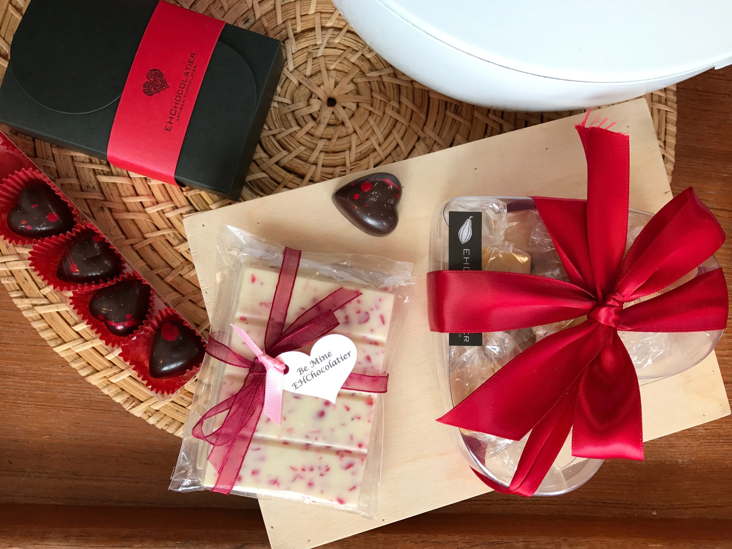 Valentine's Black Box Assorted Bonbons (6-piece), Heart Box of Passion-fruit Caramels (10 pieces), Red Hot Crunch Bar (set of 2), Bee Mine honey caramel spice Bonbons (5-piece)