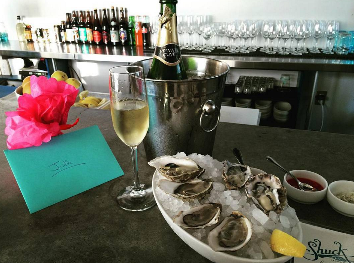 $2 off Wine during Happy Hour  photo courtesy of Shuck Oyster Bar on Instagram