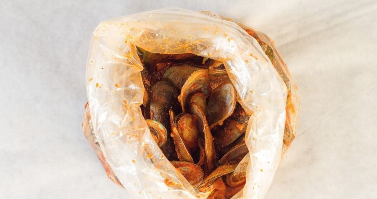Bag of Mussels in The Boiling Crab's Wholeshabang Sauce   photo courtesy of The Boiling Crab
