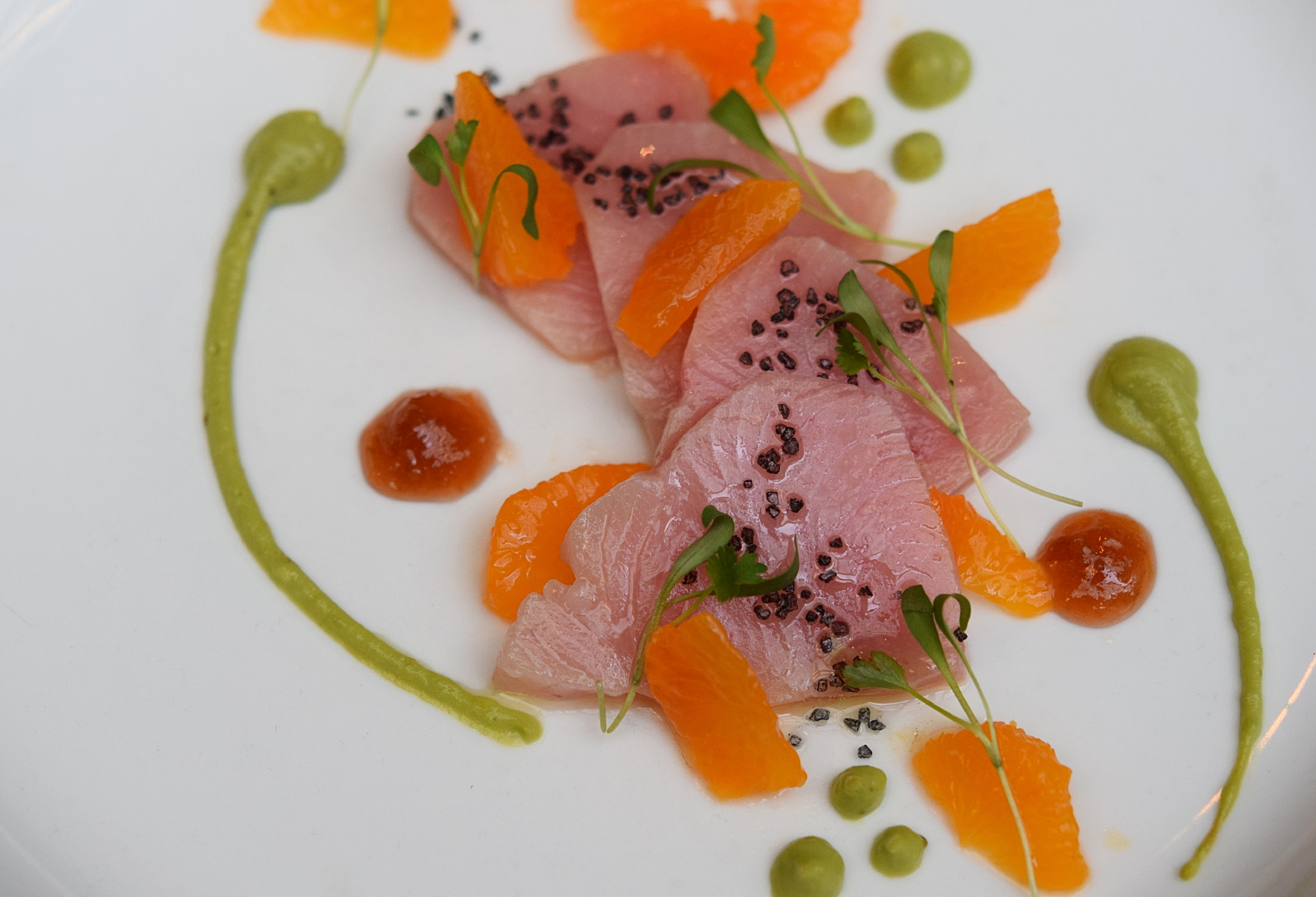 First course of Chef Niki's Adele-inspired tasting menu,  Hello, featuring hamachi and tangerine
