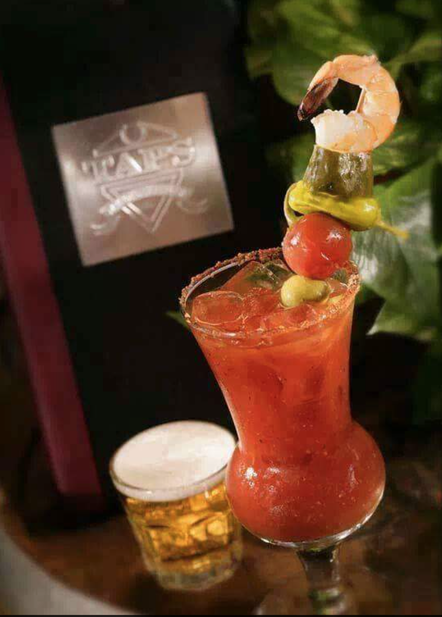 Taps' Bloody Mary and impressive garnish (or meal on a stick?) |  Photo courtesy of Taps Fish House via Facebook