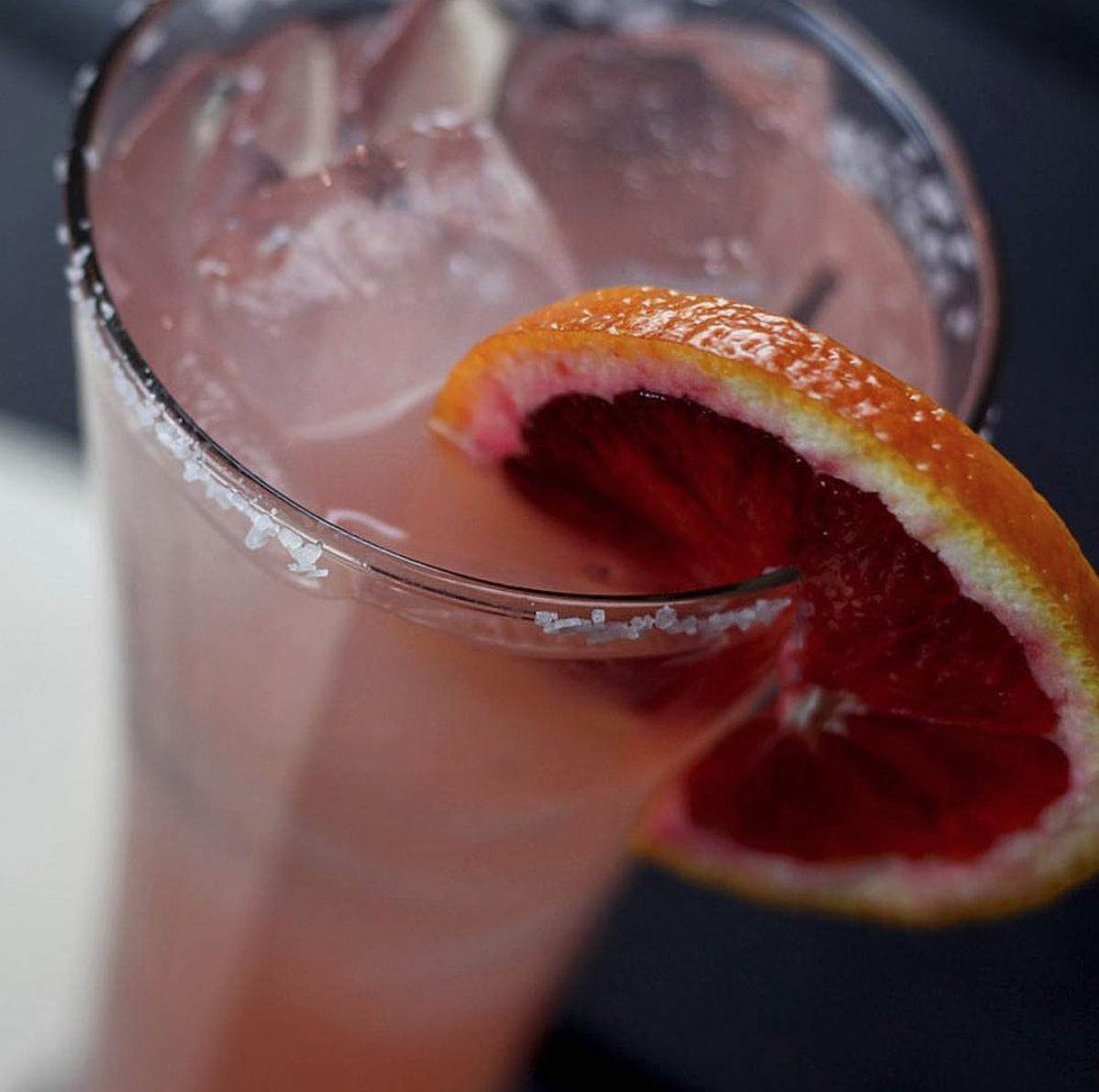 Expect more happy hour offerings in the near future, like this blood orange concoction, at Citizen Kitchen | Photo courtesy of Citizen Kitchen via Instagram
