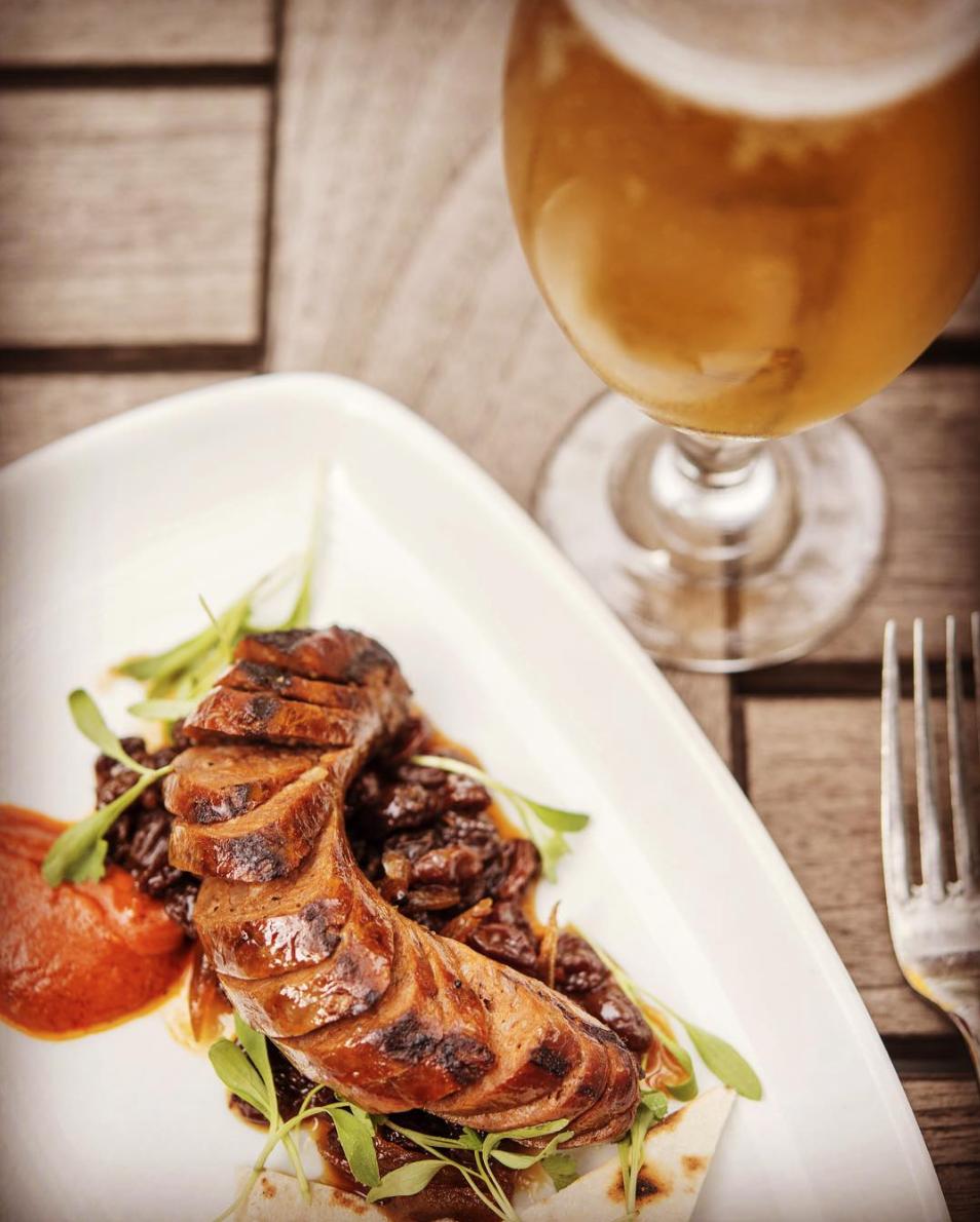 Bistango's Happy Hour boasts elevated dishes like the lamb sausage with apple raisin chutney | Photo courtesy of Bistango via Instagram