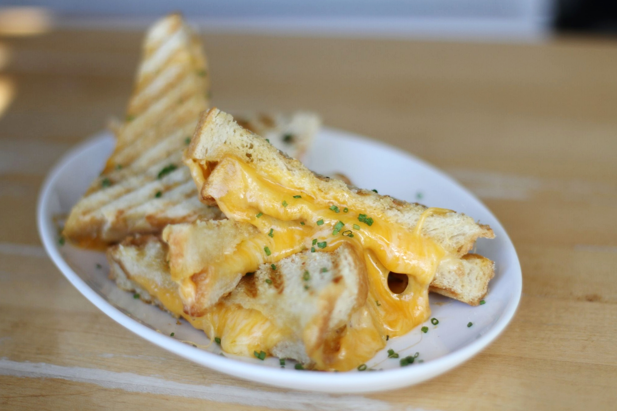 Shuck's beloved Grilled Cheese | made with three ingredients: cheese, butter, and love