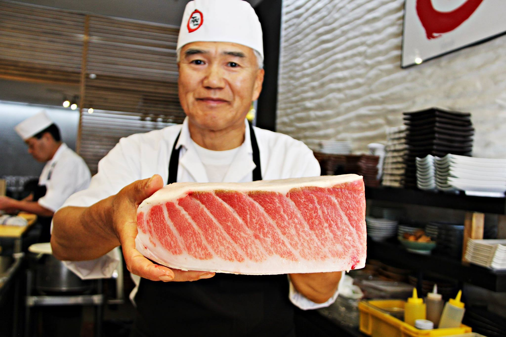 Chef Kurt Chen shows off a prized cut | photo courtesy of OoToro