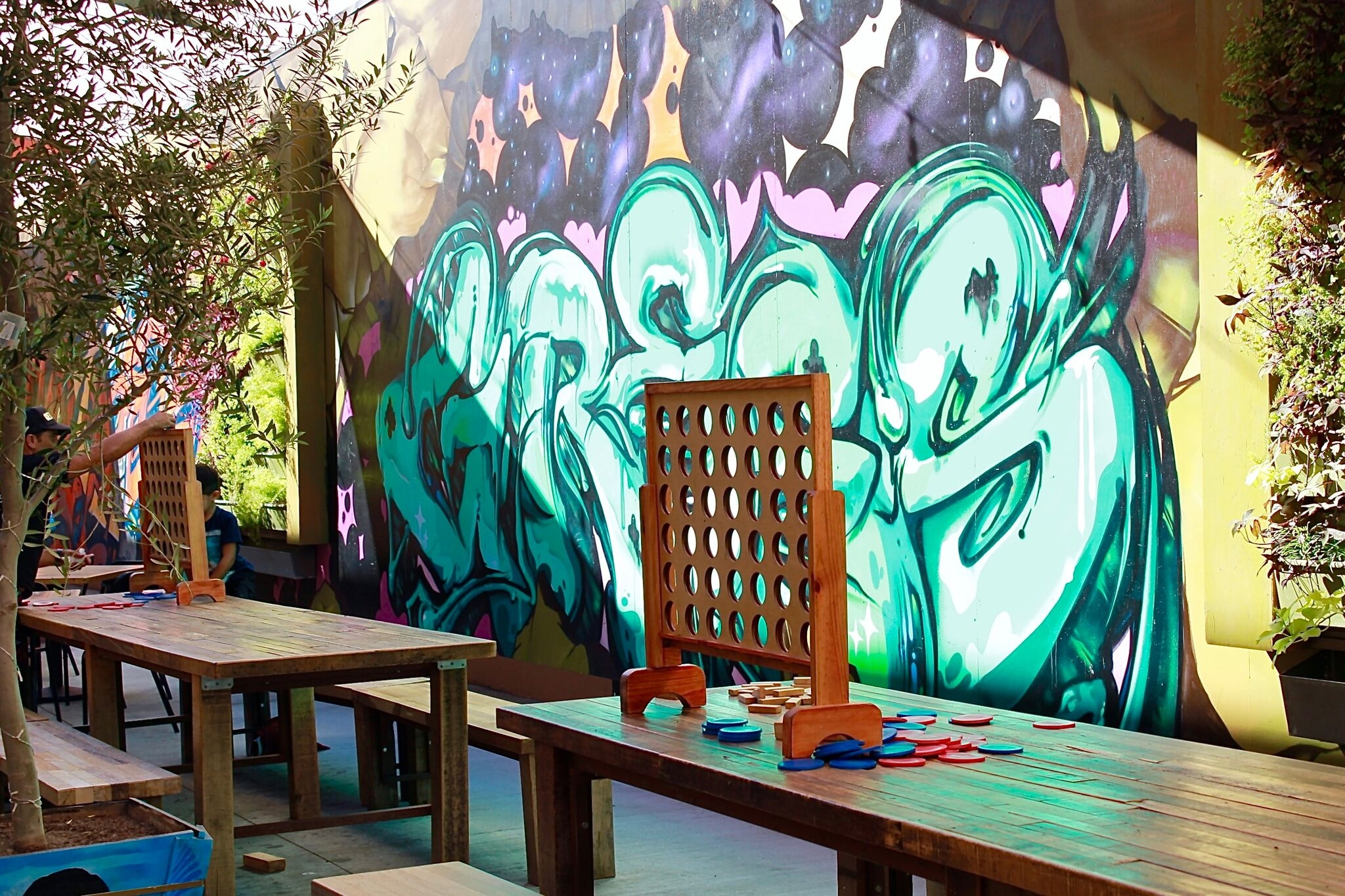 Kids and adults alike will love the varietal food options, not to mention the award winning patio which comes complete with games, at 4th Street Market in DTSA | photo courtesy of 100eats