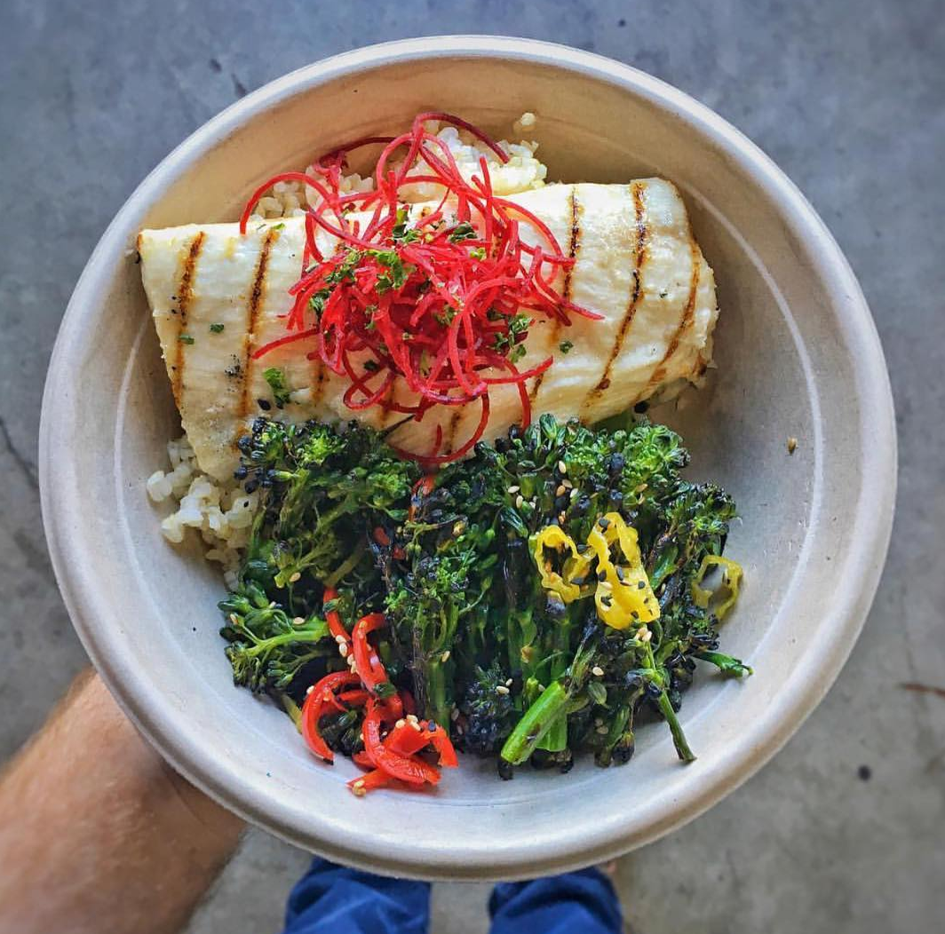 Get your hands on fresh-fish-filled wraps at West Coast Fish | photo courtesy of Marc Kharrat