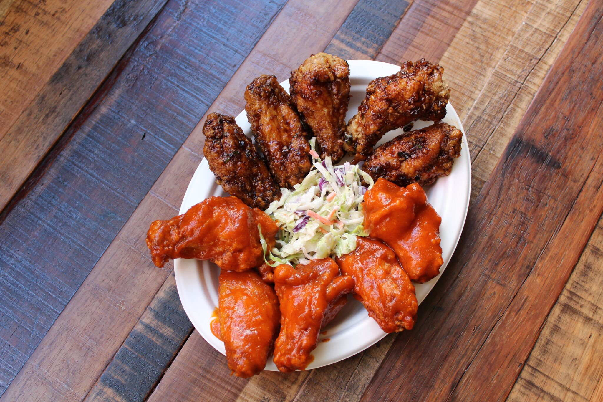 Bring your best wingman to devour some cluckin' good wings together at WINGMAN, located at 4th Street Market in downtown Santa Ana, CA | photo courtesy of 100eats