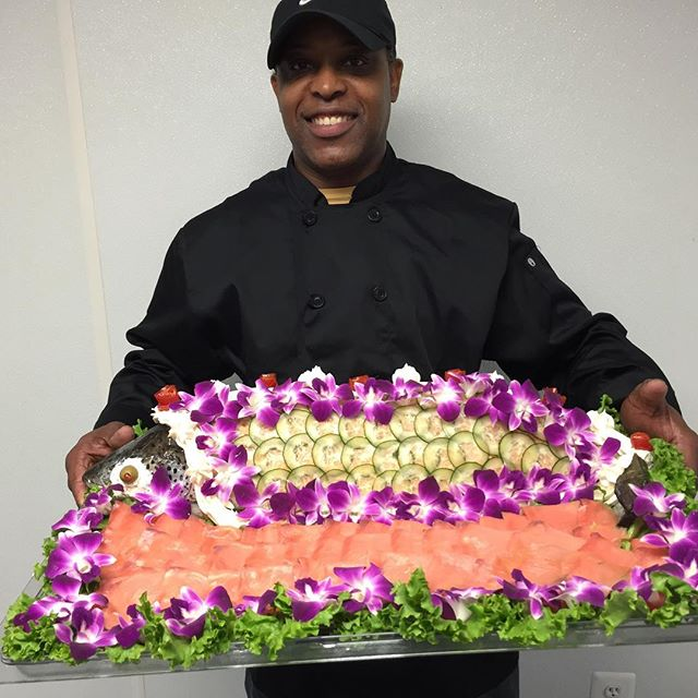 Rx truly has a talented team - Chef Lester doing his thang with a whole decorated fresh salmon dressed with smoked salmon! 🍣 Definitely something delicious and made with 💜! 703-535-6955  #rxcateringdc #salmon #smokedsalmon #dressedsalmon #seafood #dcfoodporn #dcfoodie #vafoodie #catering #cateringservice #cateringlife #whycook #letuscateryournextevent #delicious #smallbusiness #smallbiz #womanownedbusiness #blackownedbusiness #entrepreneur