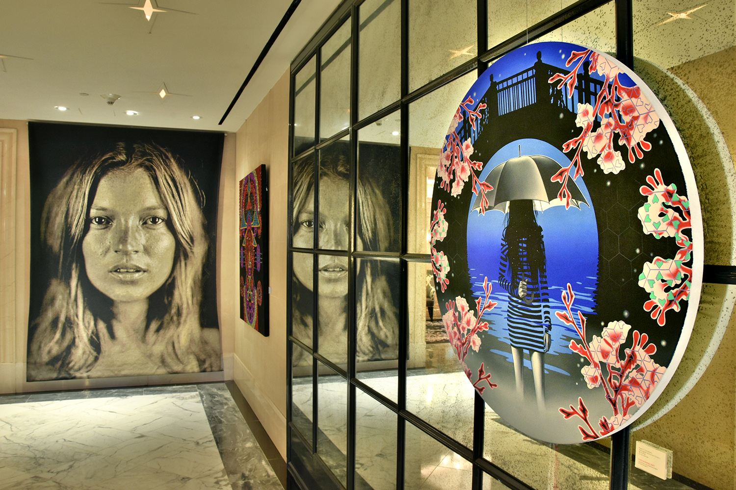 Peter D. Gerakaris' MoonGate Nocturne Tondo I (right) from  Umbrella Girl Series , Installation view from Fashioning Art Group Exhibition at The Surrey Hotel in NYC. Also pictured: Chuck Close's Kate Moss tapestry from permanent collection (left) & Evie Falci's Kybele (center) in Fashioning Art.