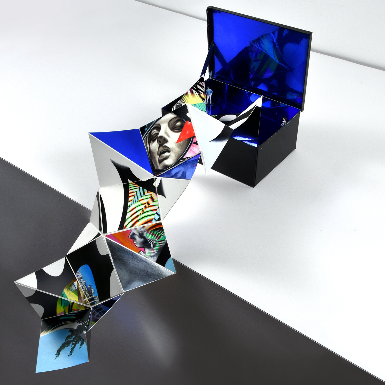 Pandora's Box   Origami Sculpture for Mykonos Biennale 2019. Gouache, acrylic, mirrored mylar, & paper on yupo w/ painted figurines in mirrored box. Approximately 26 in x 8 in x 6 in (66.04 cm x 20.32 cm x 15.24 cm). 2019. Exhibited as part of Antidote Treasure Hunt on Delos Island.