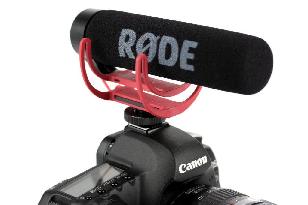 The R0DE VideoMic is a great start. It's affordable and much better sounding than your DSLRs built in microphone.