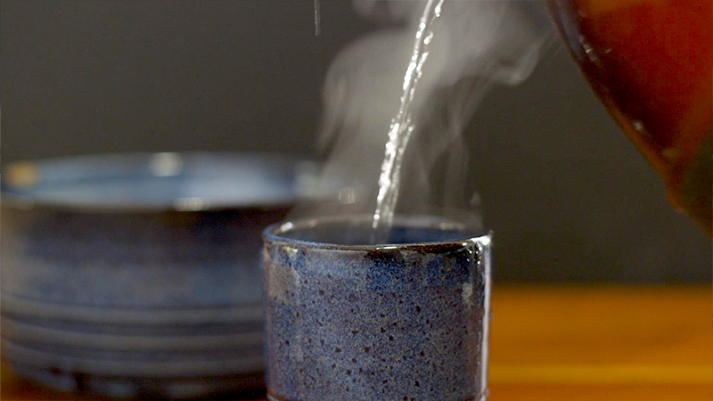 The steam from the cup and the hot water poured in pop when lit 3/4 back.