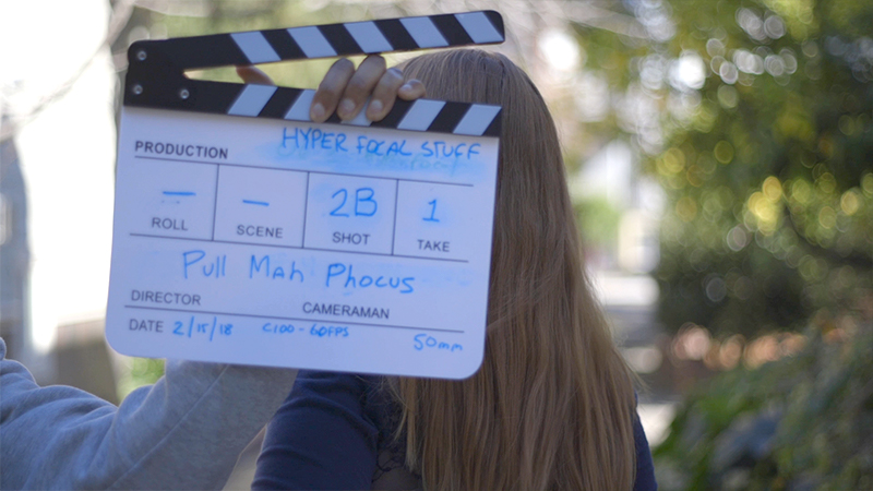 Traditional clapper slate with shot and camera notes, done Pull My Focus style.