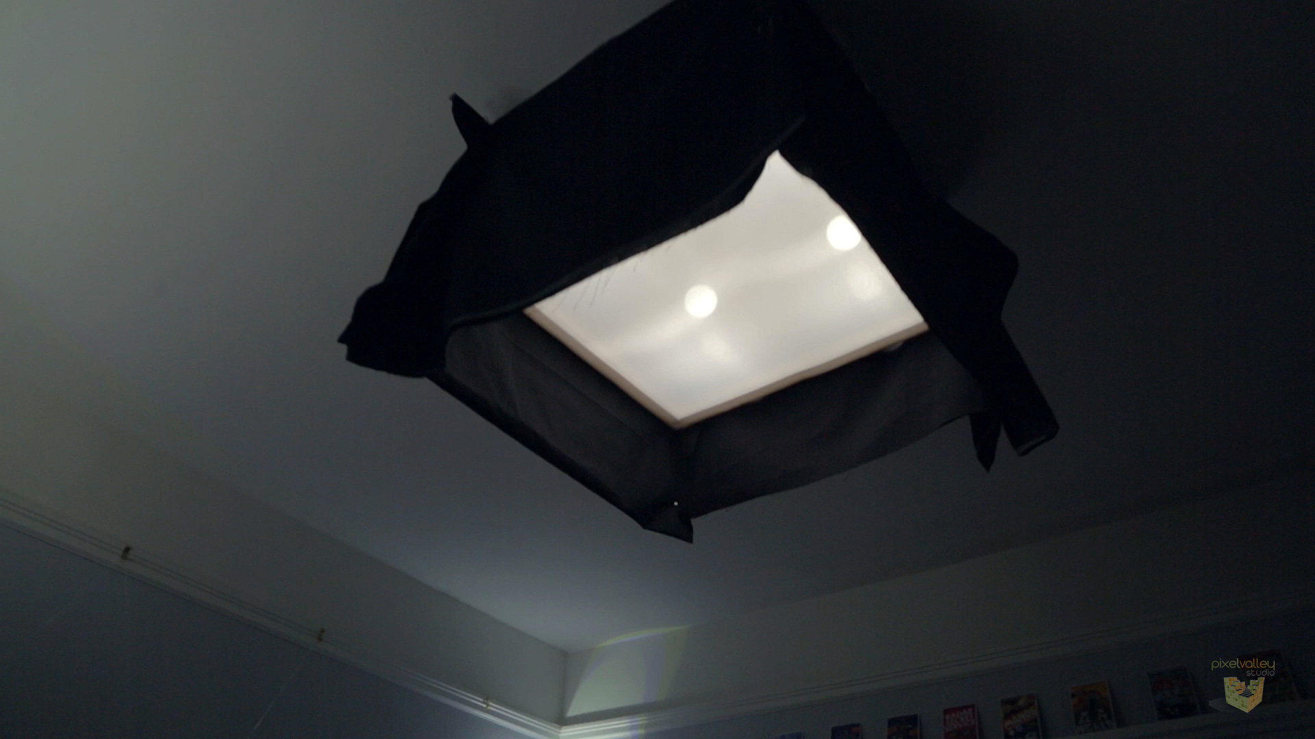 Our box ceiling light with showcard sides and a duvetyne skirt to focus a soft beam of light straight down.