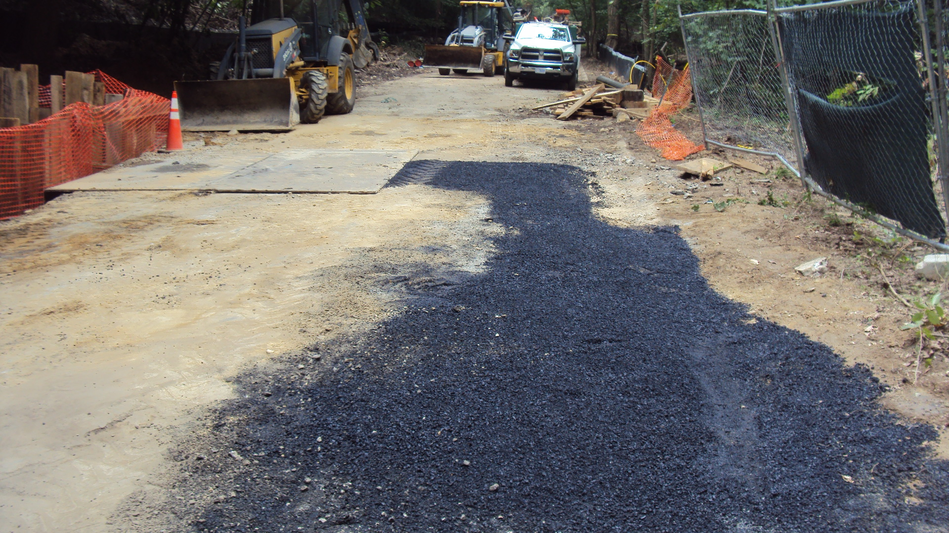 Backfill topped with asphalt to prevent erosion between now and trail construction