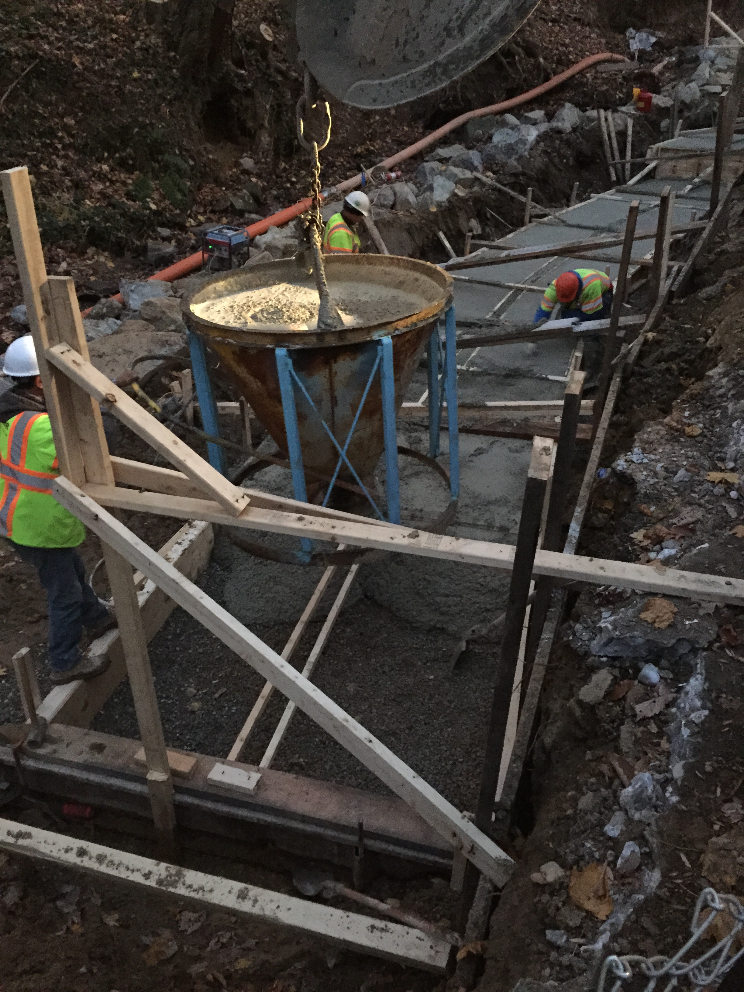 Placing concrete in the foundation formwork using a hopper bucket