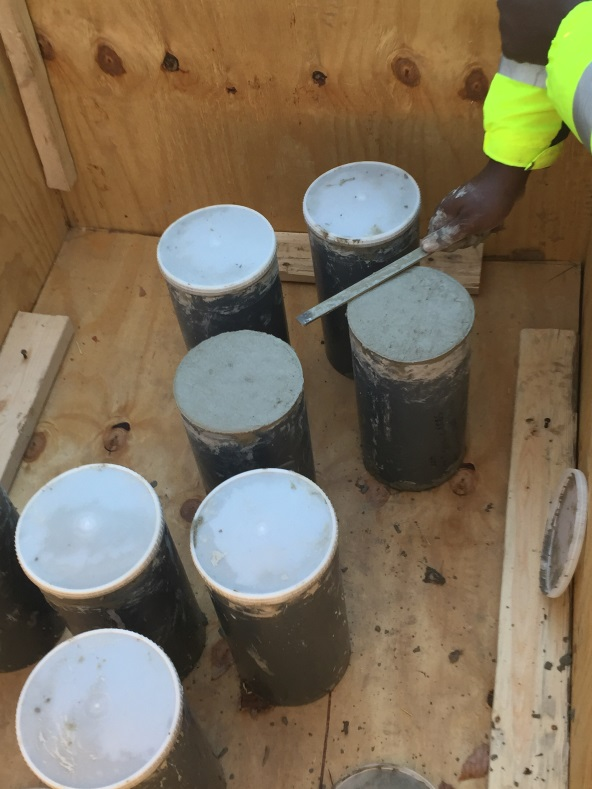 Samples of the concrete are taken in plastic cylinder molds, cured overnight, and taken to DDOT's QA/QC lab for strength testing at 28 days.