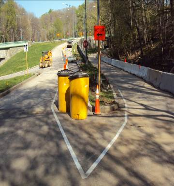 Setting up the work zone for sidewalk construction from Porter Street to the connector trail