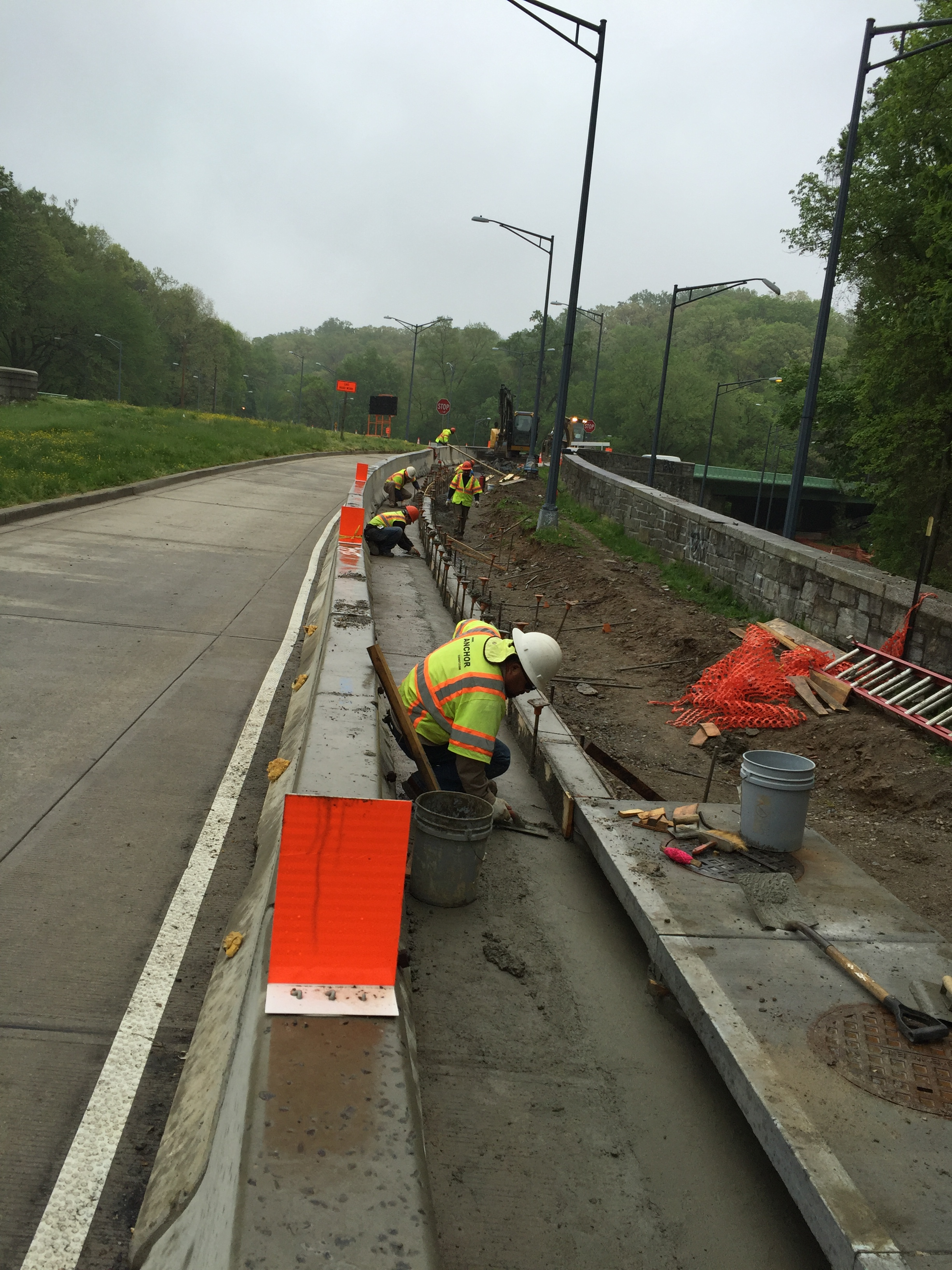 Once the water quality structure was set, the crew then placed the new concrete curb and gutter