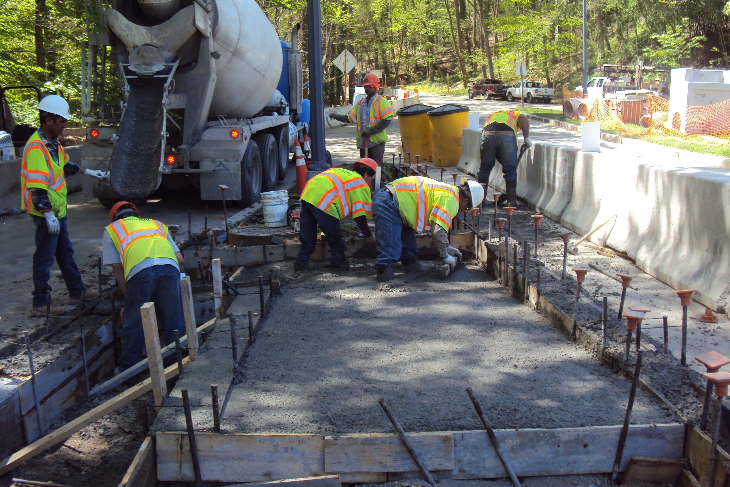 Placing concrete for the Klingle Road to Porter Street Connector Ramp ADA ramp