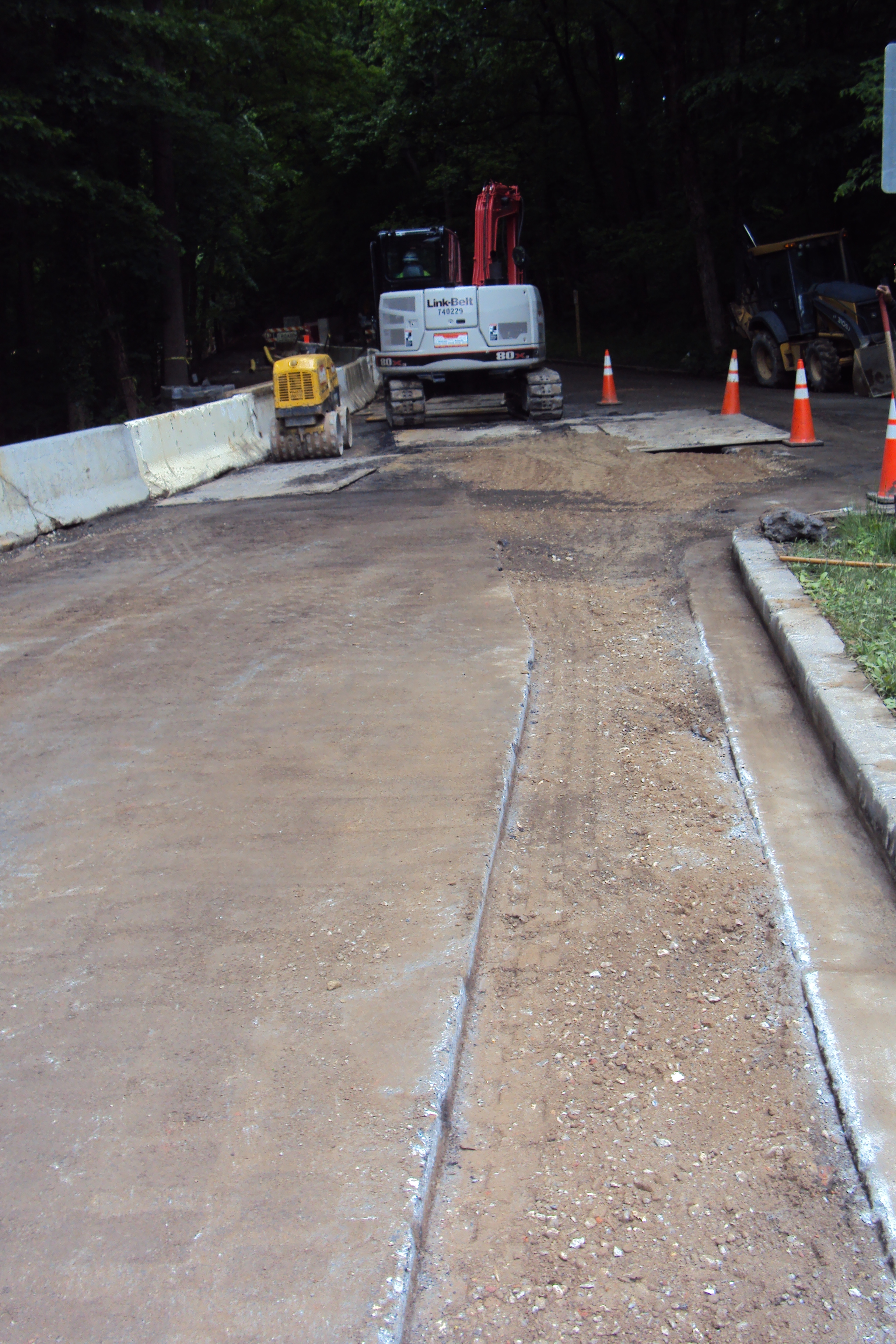 Sawcutting the existing roadway to prepare for trenching