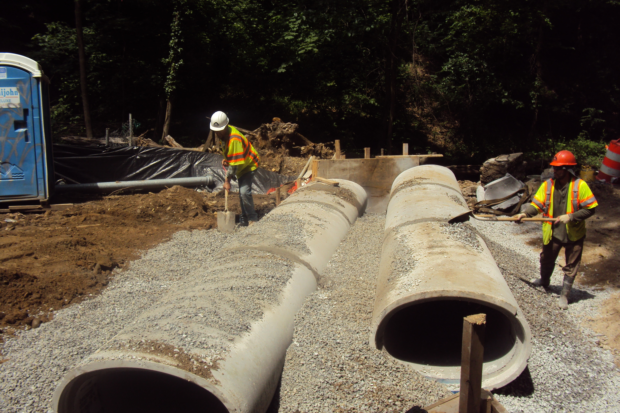 Backfilling the pipe runs with stone
