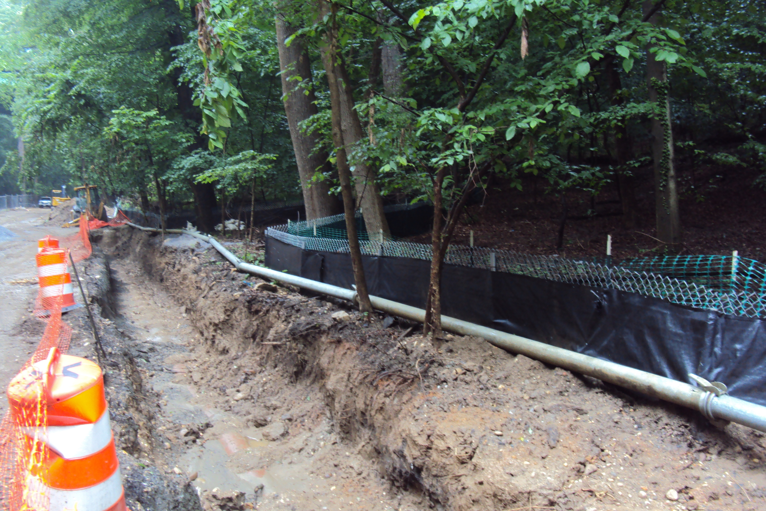Bypass pipe and pump in place for sanitary sewer removal