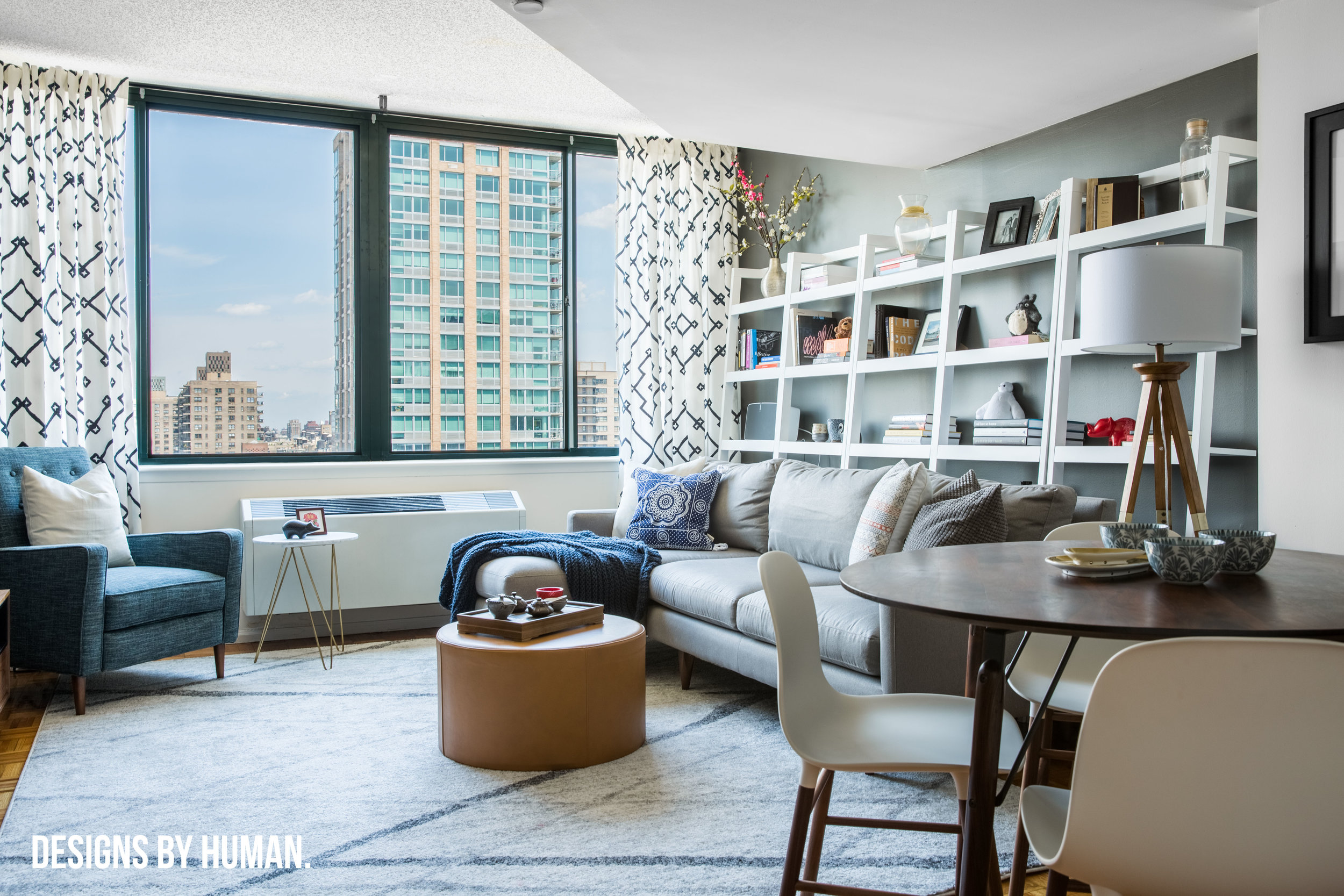 Living Room - Feng Apartment by  Designs By Human . We used dark gray accent walls to help to add depth to the space.
