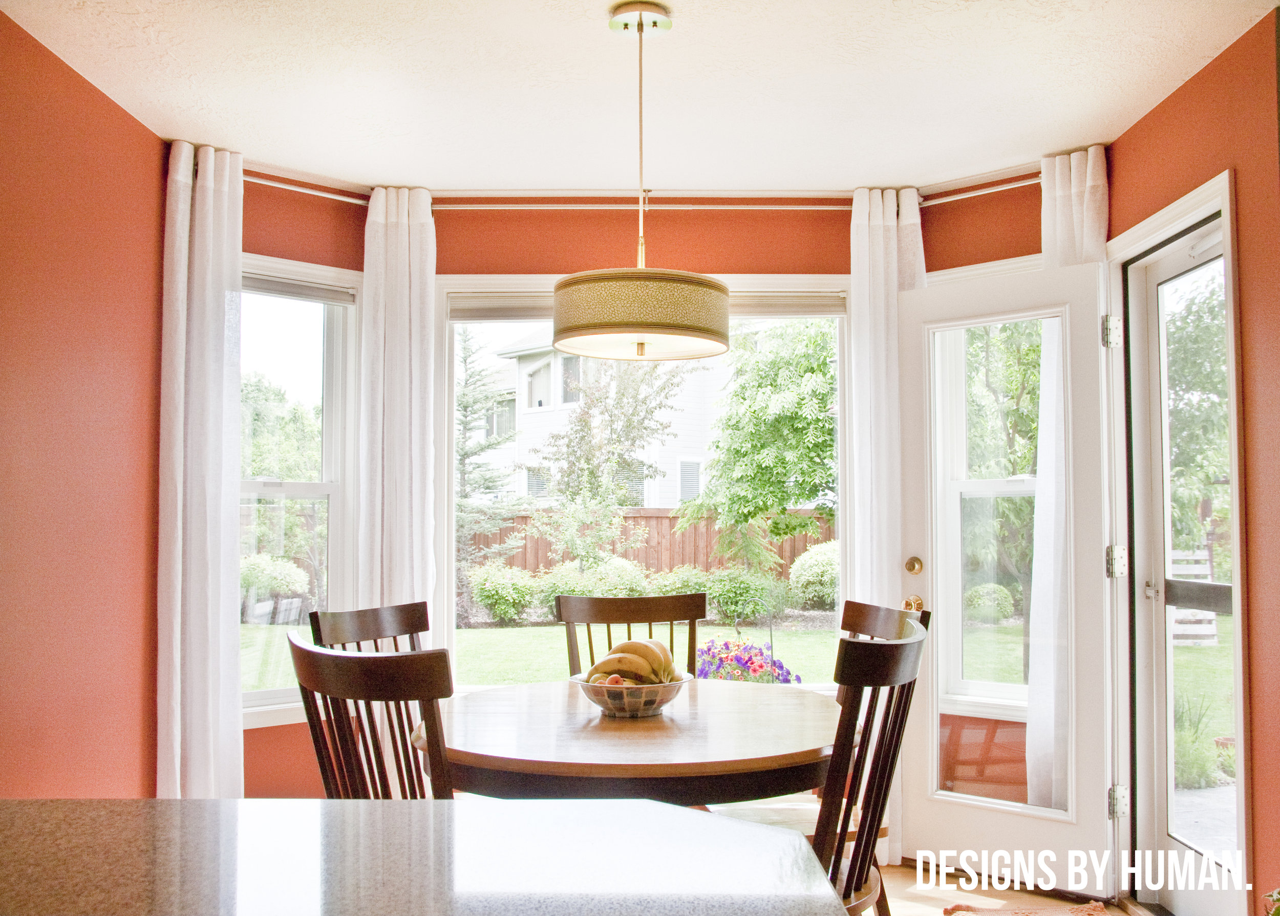 Dining Area - Surprise Valley Residence by  Designs By Human . This rich orange is accented with white window trim and treatments. (Check out our recent feature of this project in  Elle Decor !!