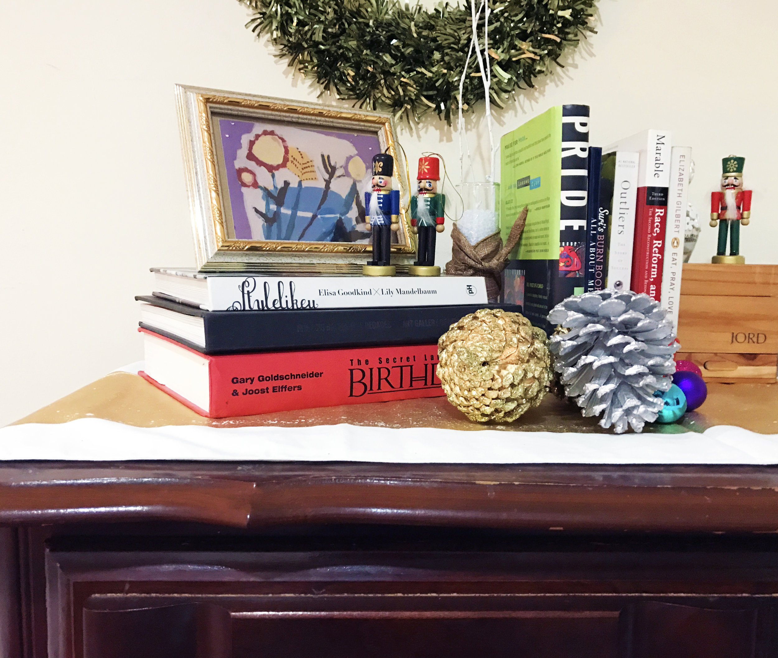 A mix of personal objects and Christmas decorations.