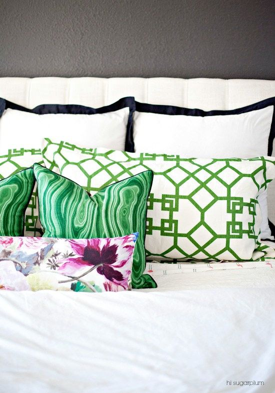 You can incorporate Greenery in a subtle way by using accent pillows. We like  this example  from Hi Sugarplum.