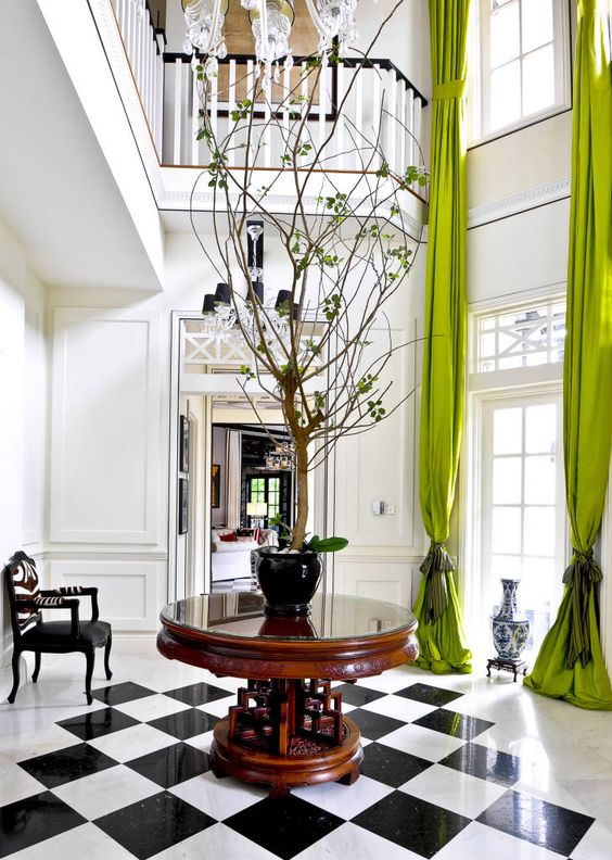 This luxe black and white interior space is brought to life with the addition of green drapery. Image source:  Interiors By Studio M .