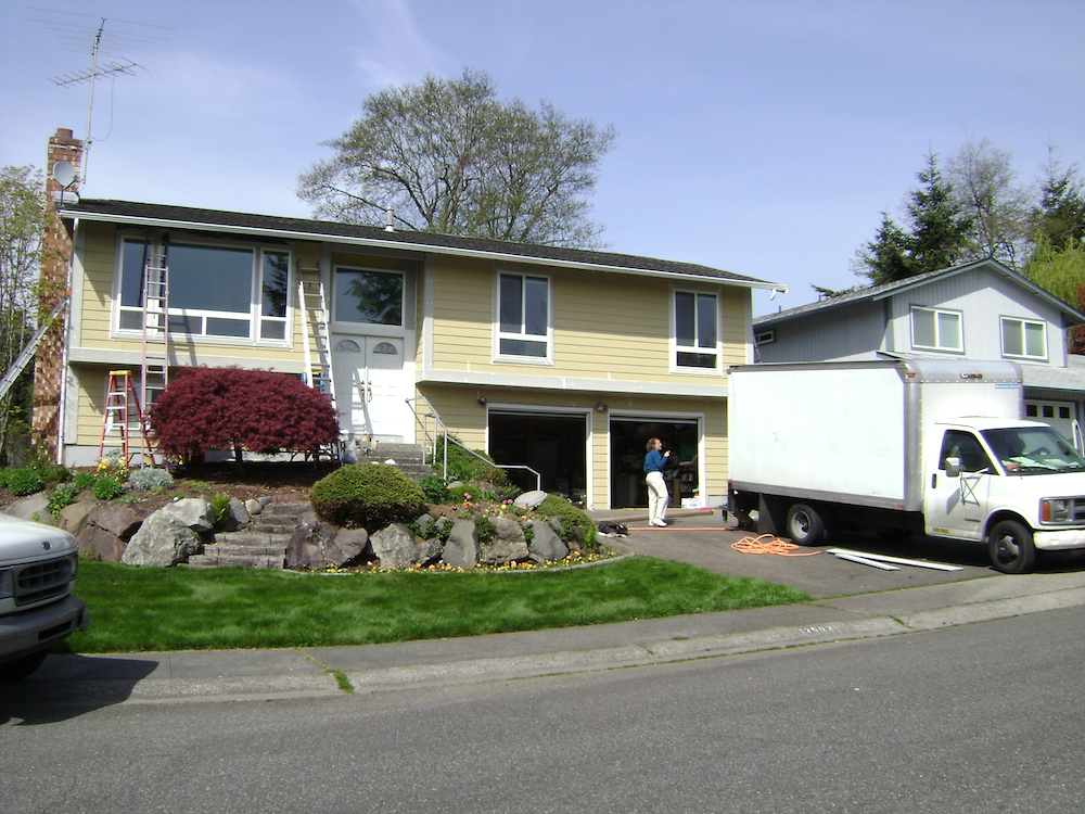 The Multifacet team in progress of prepping the house before beginning to apply the exterior paint.