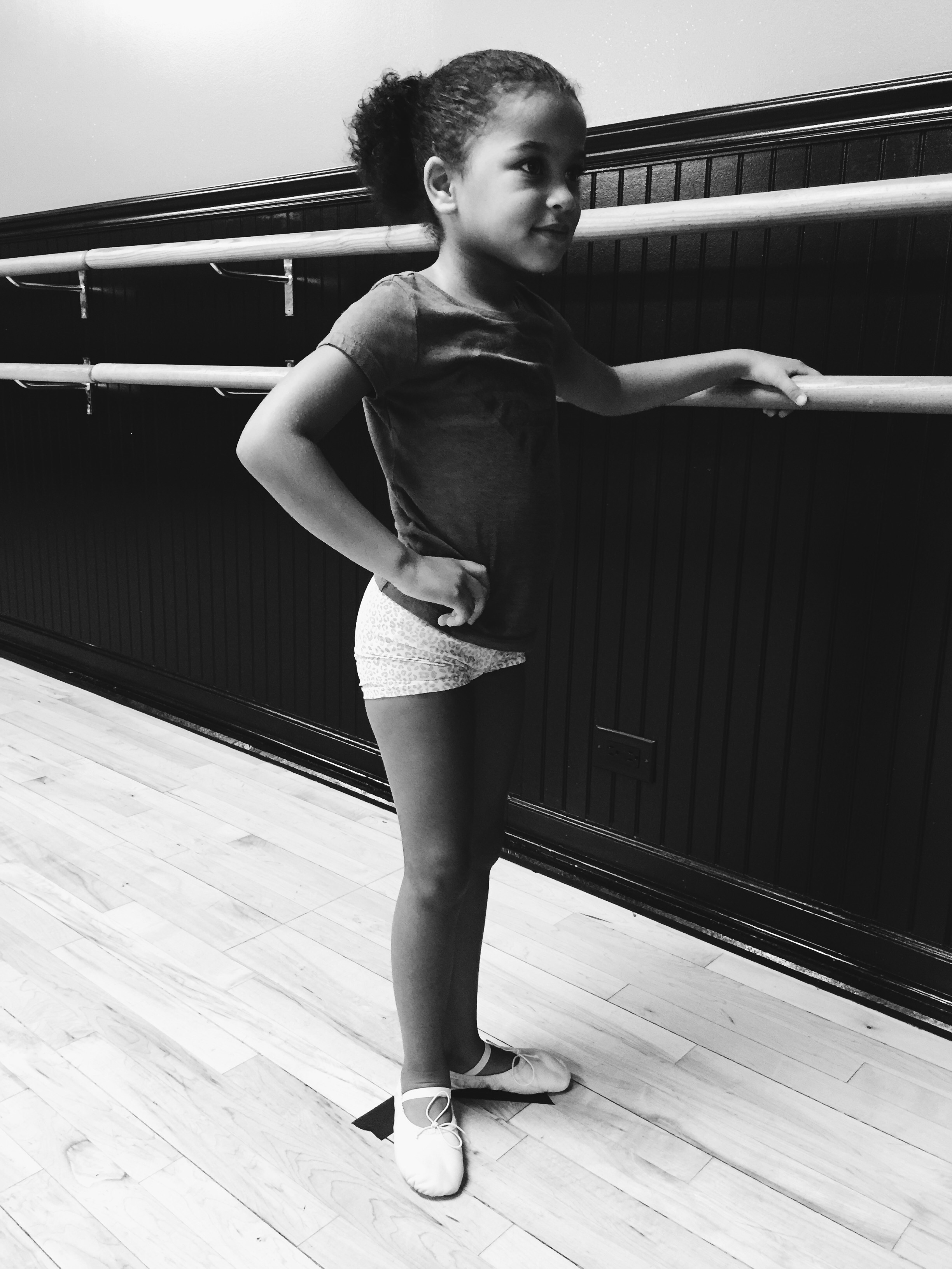 Kaydence learning relevé, plié, and first position.