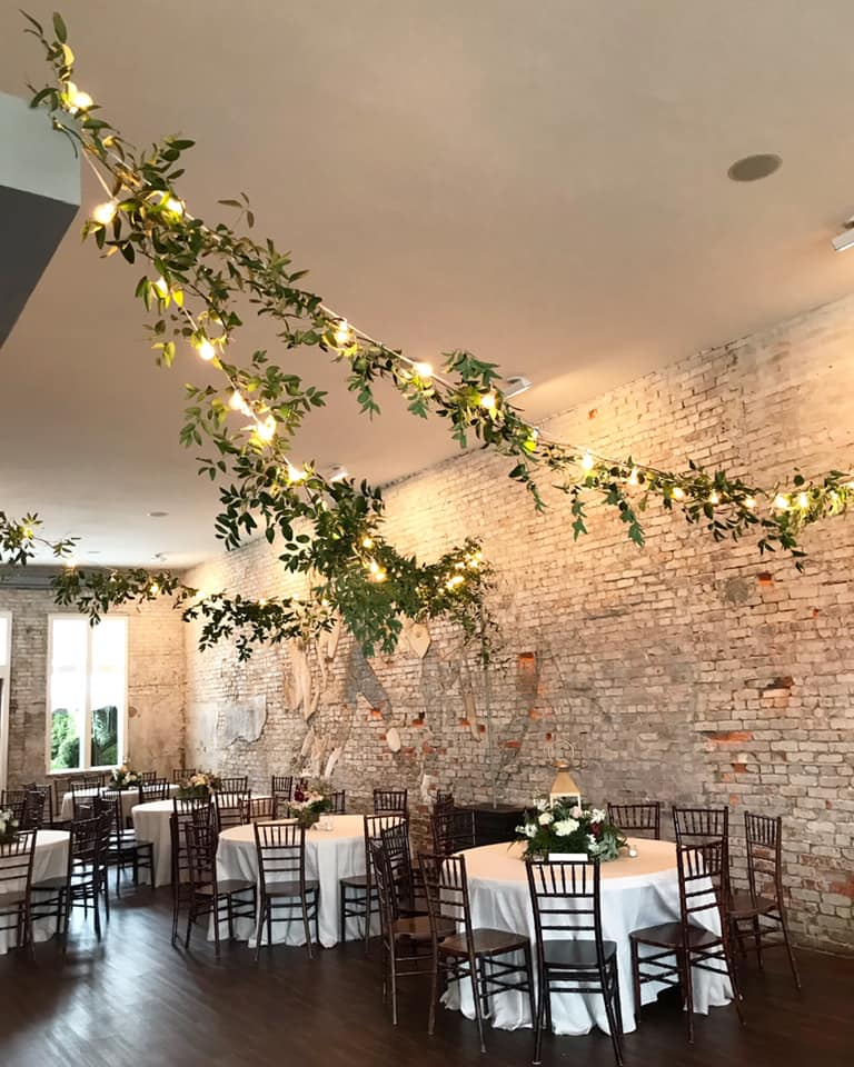 Lighting + Draping - We specialize in professional installation of lighting and draping. We offer Bistro Strung Lighting, Chandeliers, Spot lighting, and GOBO monograms. Draping can transform a space or tent, and create a more intimate and soft appeal to your celebration location.