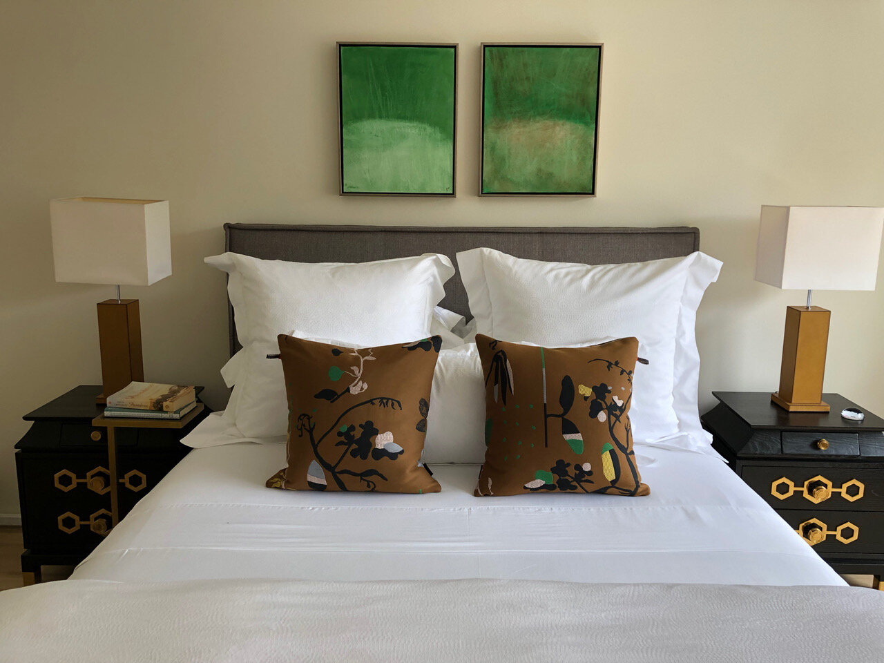 We love the simple pop of color above this bed. Paintings by artist  Kari Kroll .