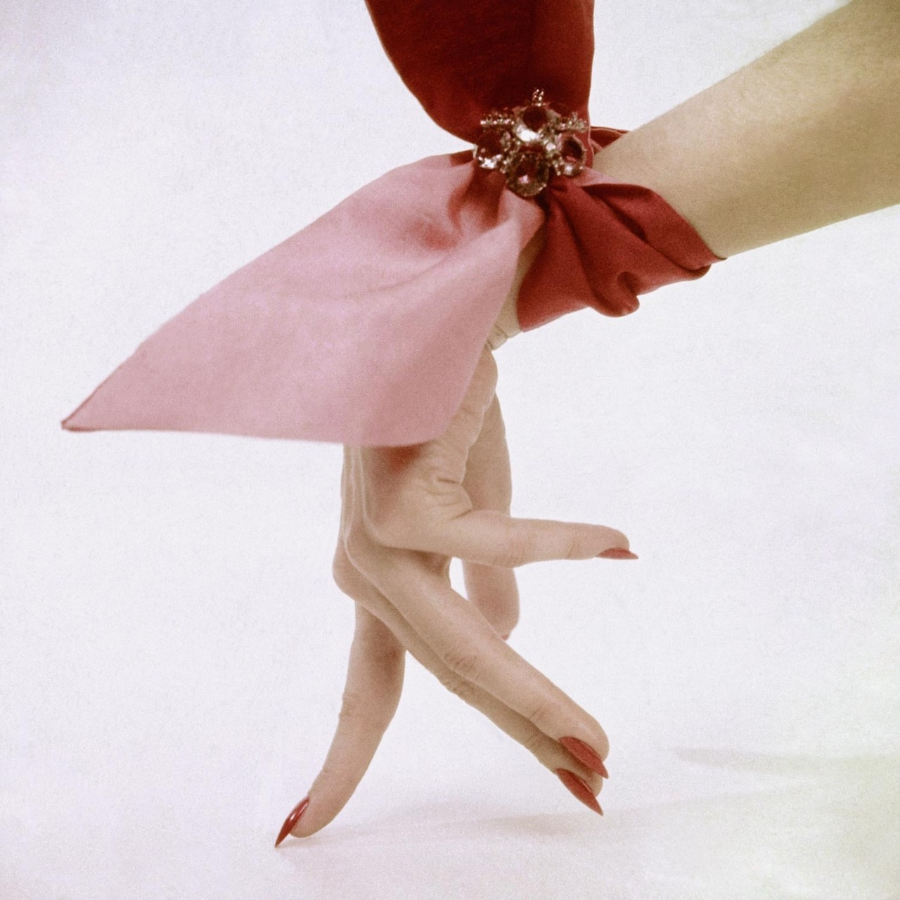 pink-wrist-scarf-photographed-by-clifford-coffin-in-1951.jpg