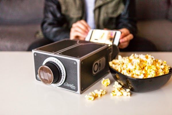 17.      Gee-Whiz Smartphone Projector      ($27.00) Watch your smartphone videos anywhere, hands free, magnified on a wall with this simple, power-free projector.