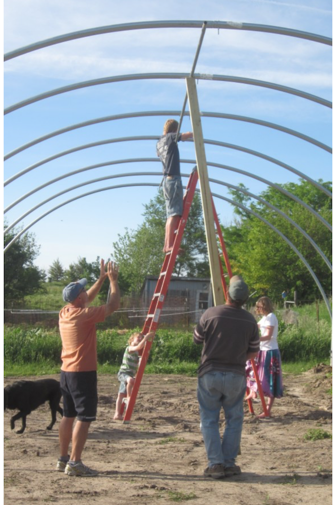 Putting up the hoop house or high tunnel for Old Depot Farm. My role now? Loading up the produce every Tuesday morning.