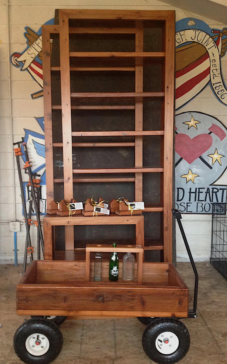 Here are some of the shelves and other Christmas projects—vase stand, and guitar neck rests. Notice the same sign in the background that was in the earlier tear-off picture. No floor yet. Finishing the walls first.