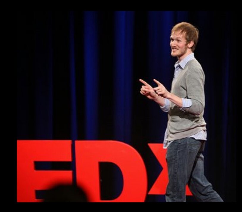 Andrew delivering his TEDx talk.
