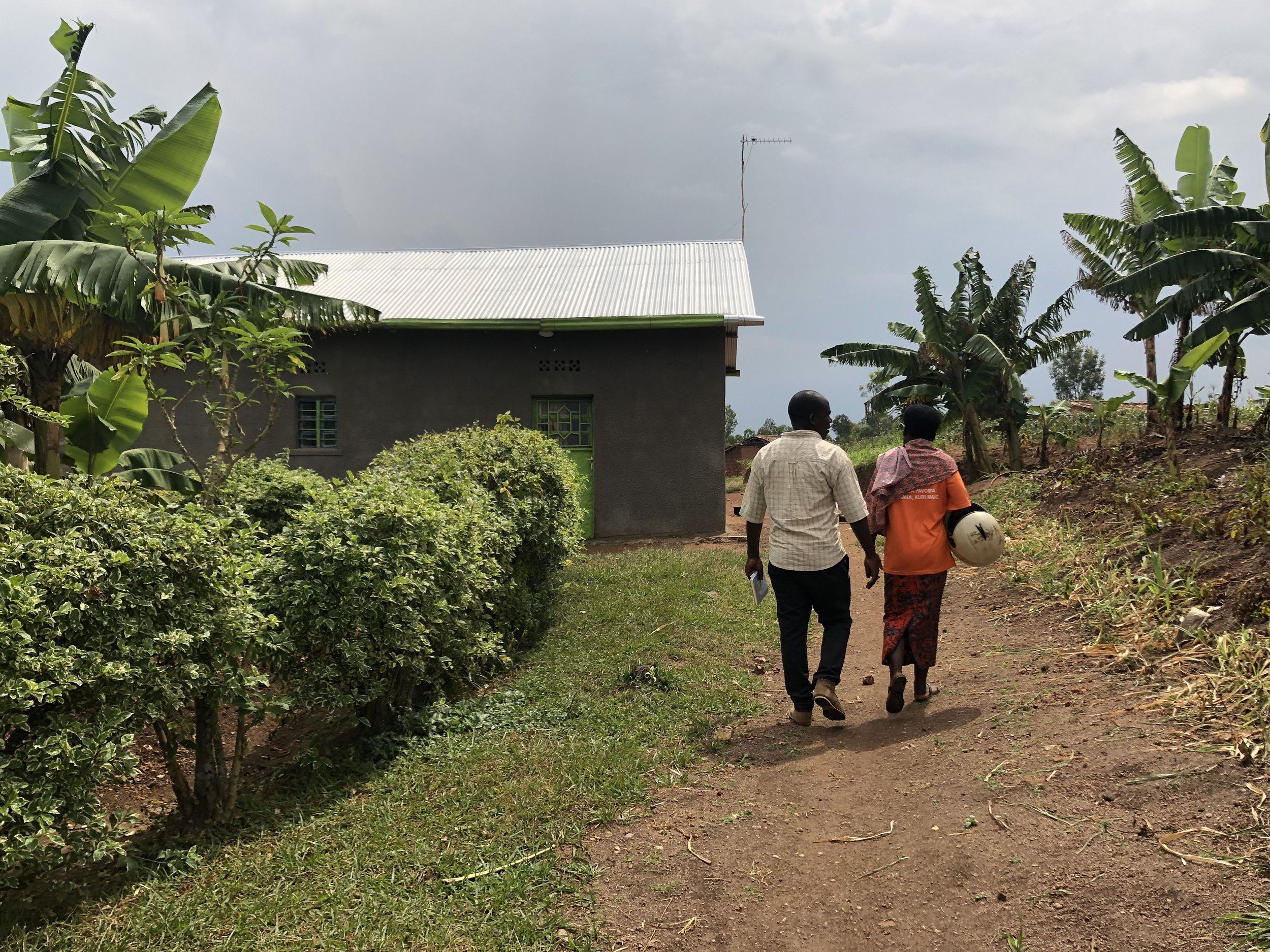 My field parter, Jean Baptiste, leading the way to customer's houses. We walked door to door to visit customers at home.