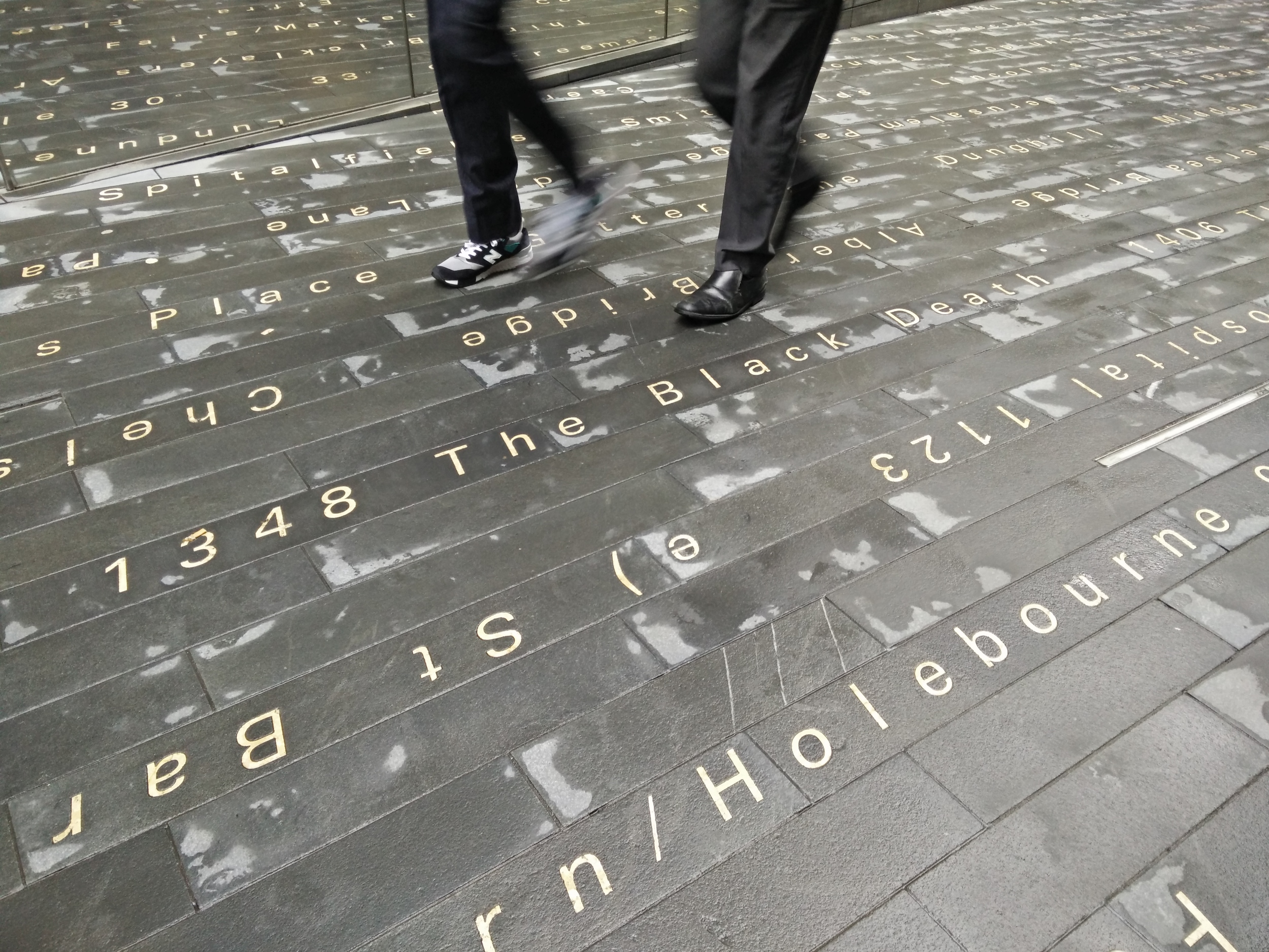 During daytime, the text steals all the attention. Light however plays an important role in the work, installed both as stripes on the pavement and as a backlit, wall sized picture of the moon's surface - a landscape that has stayed the same while London has changed over the centuries.