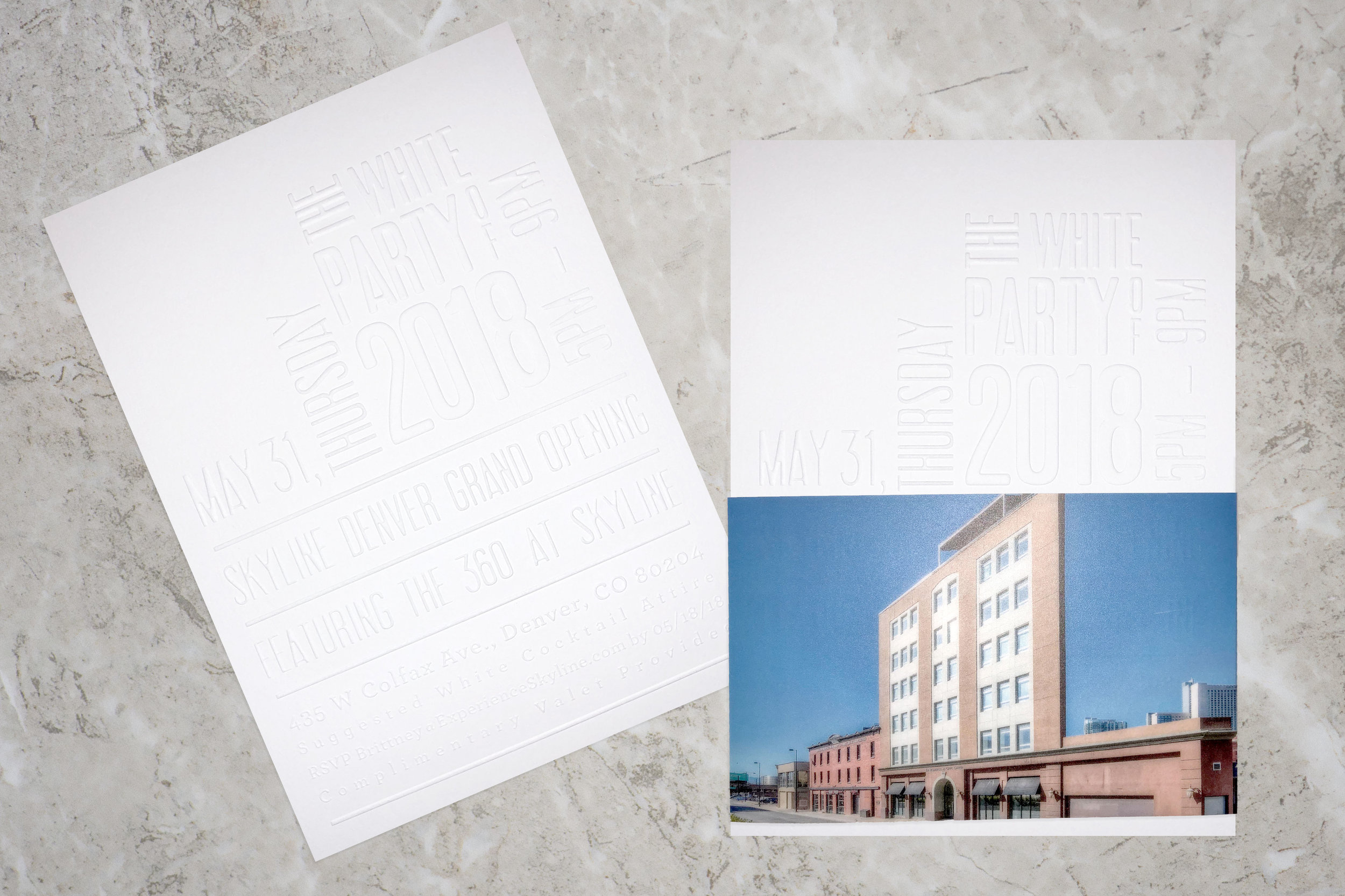 The White Party of 2018 Invitations for Skyline Denver Grand Opening were blind embossed on Crane's Lettra 110# fluorescent white 100% cotton paper. Vellum wraps around band was digitally printed.