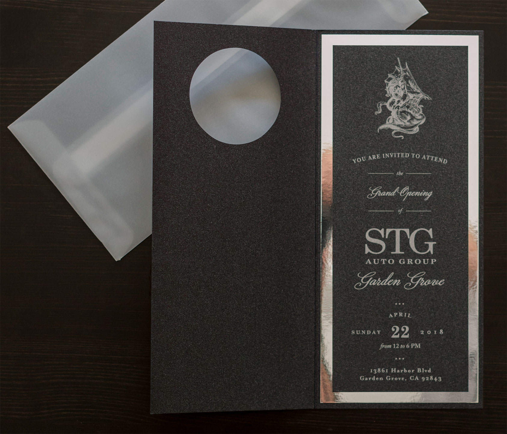 Garden Grove Grand Opening Invitations were printed on black shimmery paper with digital silver ink, layered with polished silver paper and custom die-cut black folded card. We used vellum envelopes so that the company logo could be seen through.